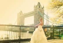 bride standing near tower bridge